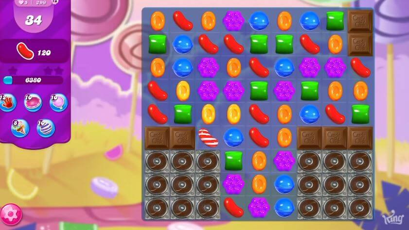 Candy Crush, a prime example of a tapping and merging game