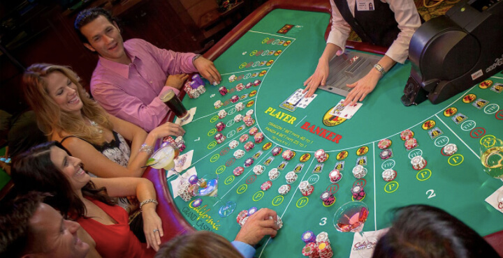 Baccarat players playing