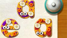 Decorating my letter cookies in Alphabet Kitchen