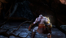 Kratos entering a cave in God of War III Remastered