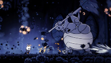 Fighting a gigantic boss in Hollow Knight